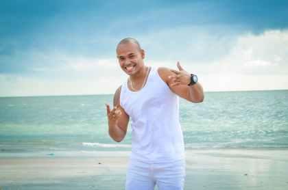 photo of man on seashore