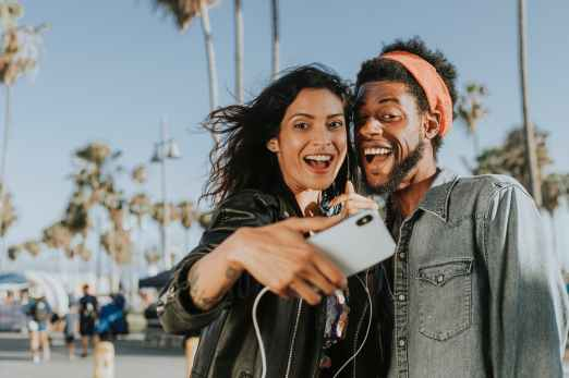 photo of man and woman taking selfie