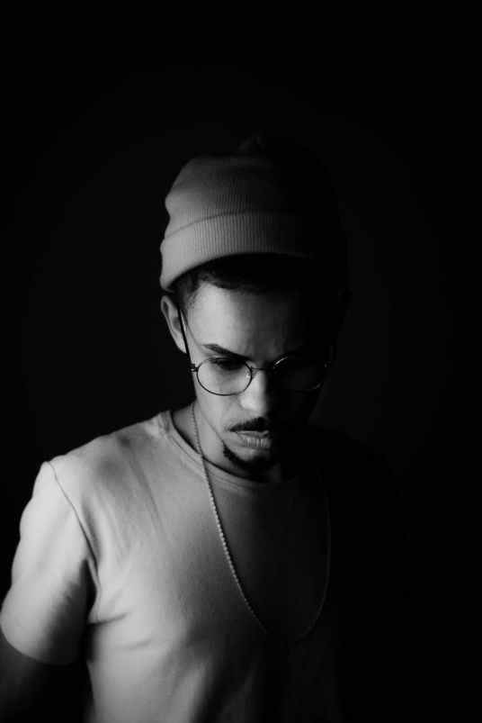black and white photo of man wearing eyeglasses