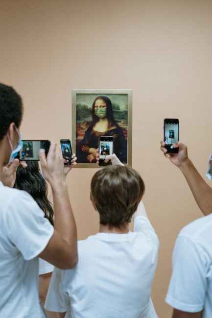 people taking picture of mona lisa painting with face mask